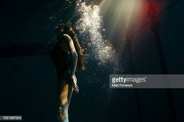 Woman arising in pool