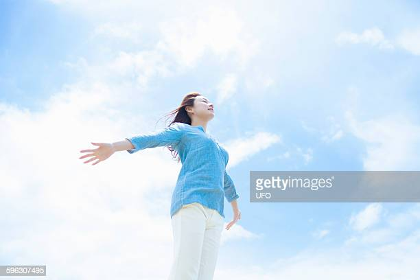 Woman arms outstretched