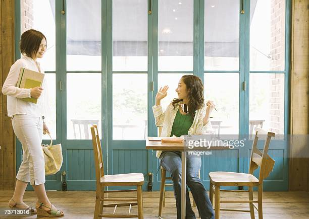 Woman arrangeing to meet at cafe