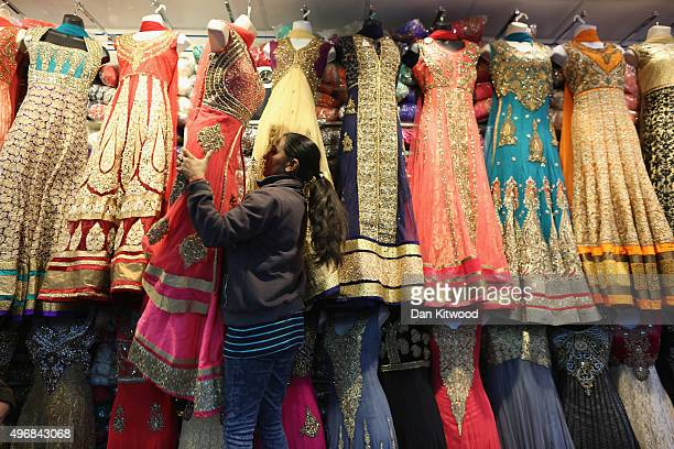 A woman arranges Saris in a shop in Southall on November 12 2015 in London England In his first trip to Britain as Prime Minister Indian Prime...