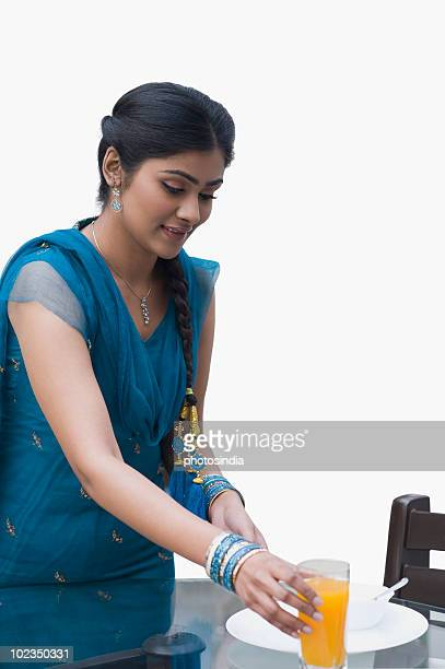 Woman arranging breakfast on a table for her husband