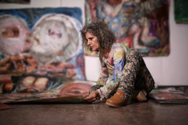 Woman arranging her artwork
