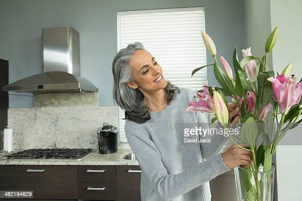 Woman arranging lilies