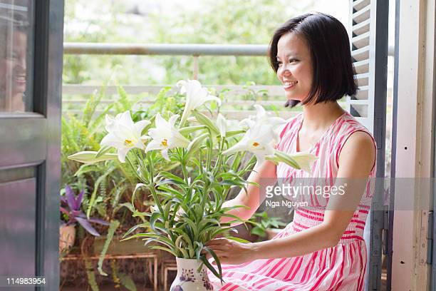 woman arranging lily flower - nga nguyen stock pictures, royalty-free photos & images