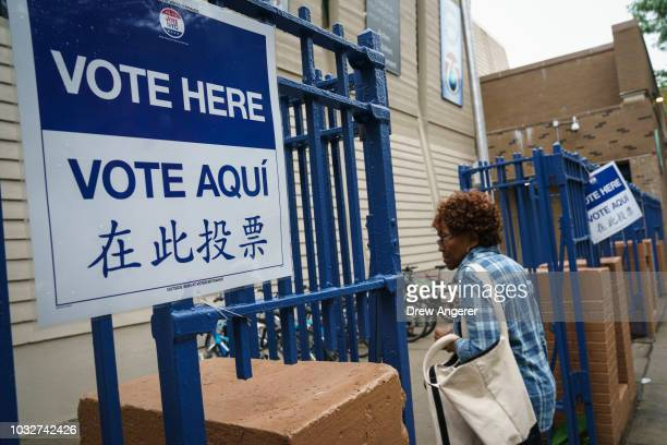 A woman arrives at a polling station on New York state's primary election day September 13 2018 in the Brooklyn borough of New York City Voters are...
