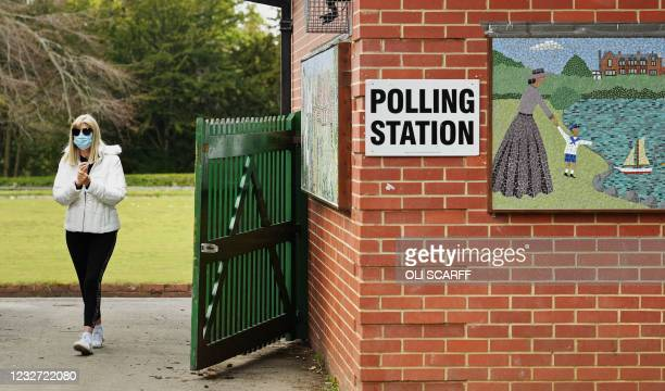 Woman arrives at a polling station set up at a bowls pavillion in a park in Hartlepool to cast a vote in local elections on May 6, 2021. - Britain...