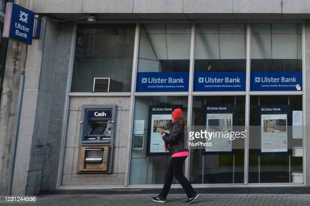 Woman arrives at the ATM outside the Ulster Bank branch in Dublin center during Level 5 COVID-19 lockdown. Tomorrow, Friday 19 February, NatWest, the...