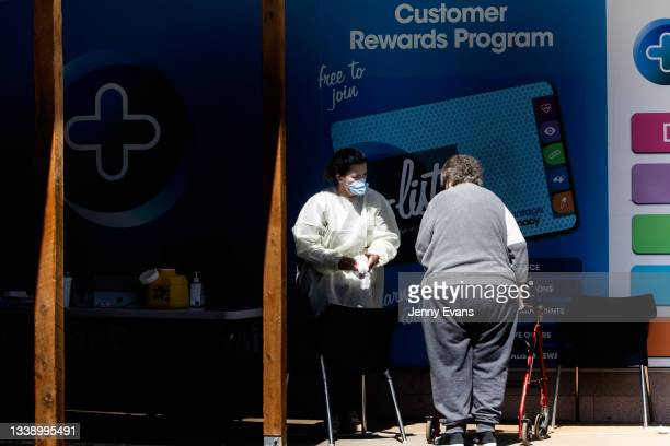 Woman arrives for a COVID-19 vaccination at a Pharmacy on September 08, 2021 in Narromine, Australia. New freedoms have been announced for fully...