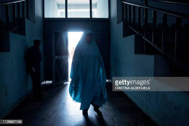 Woman arrives for a meeting against violence, organised for Muslim women, by Nigeria's incumbent President's party 'All Progressives Congress' at...
