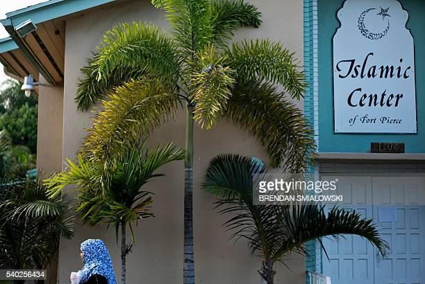 A woman arrives for prayers at the Islamic Center of Fort Pierce where Pulse nightclub shooter Omar Mateen had worshiped on June 14 2016 in Fort...