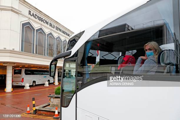 Woman arrives in a coach at the Radisson Blu hotel, where travellers are spending their mandatory hotel quarantine, at Heathrow Airport in west...