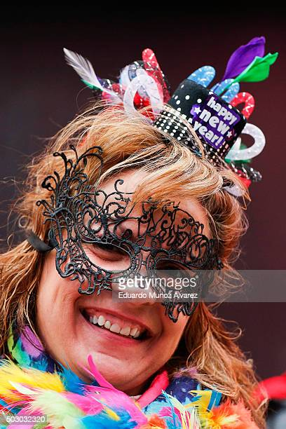 A woman arrives to take part during New Year's Eve celebrations on December 31 2015 in New York City At least 6000 police officers has being deployed...