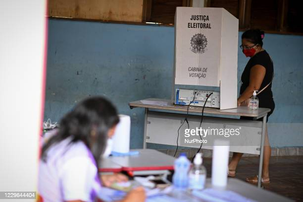 Woman arrives to vote at a polling booth during municipal elections amid the Coronavirus pandemic in Santana, Amapá State, Brazil, on November 15,...