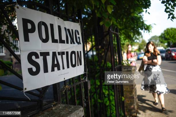 A woman arrives to vote at a polling station on May 23 2019 in Twickenham United Kingdom Polls opened today for European elections Polls are open for...
