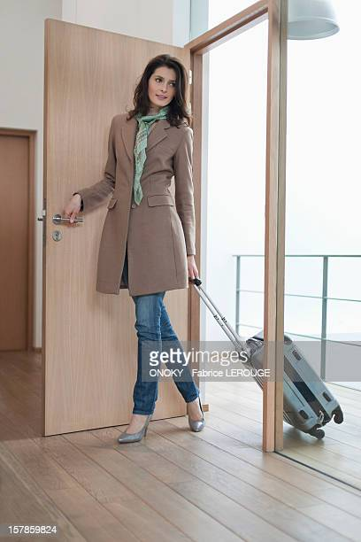 Woman arriving at home from vacations