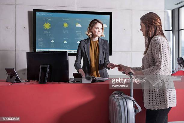 Woman arriving at reception desk