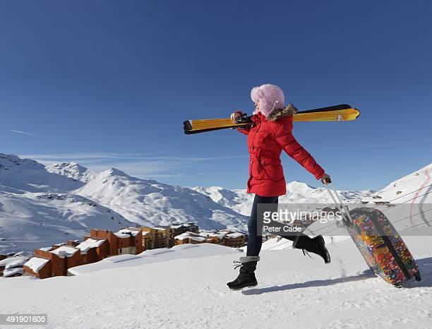 Woman arriving at ski resort