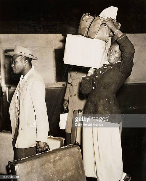 Woman arriving from Barbados 4 January 1955 A photograph of a young woman Louise Denny arriving at Victoria Station London having travelled from...