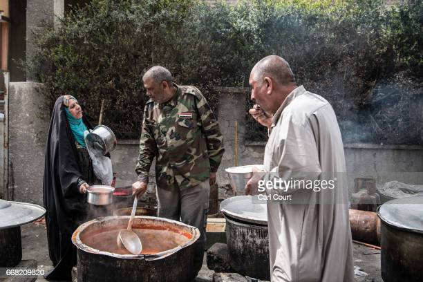 Woman asks for food at a Shia volunteer food distribution point during fighting against Islamic State in west Mosul on April 12, 2017 in Mosul, Iraq....