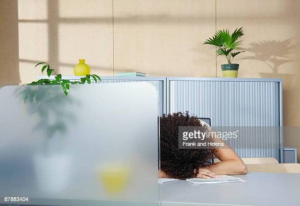 Woman asleep at desk in office