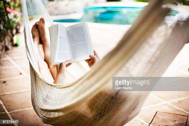 a woman asleep in a hammock - hammock stock pictures, royalty-free photos & images