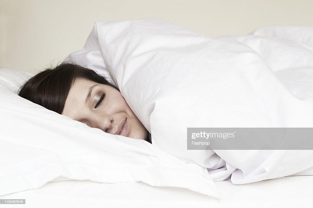 Woman asleep in bed : Stock Photo