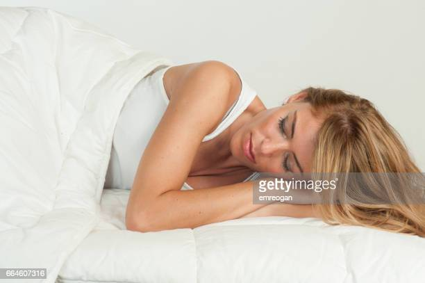 Woman asleep in bed