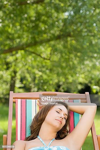 Woman asleep in deckchair