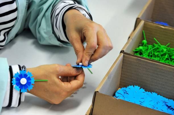 A Woman Assembles A Bleuet De France Cornflower Flower A Symbol