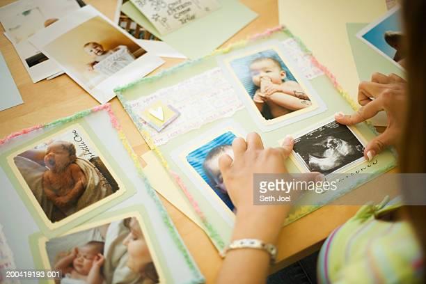 Woman assembling scrapbook