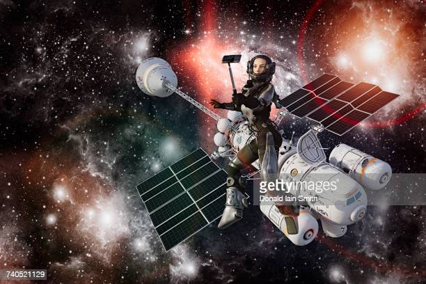 Woman astronaut posing for cell phone selfie during space walk
