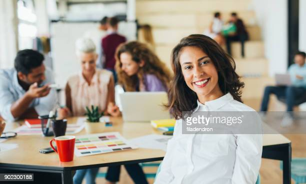 woman at a business meeting - satisfaction stock pictures, royalty-free photos & images