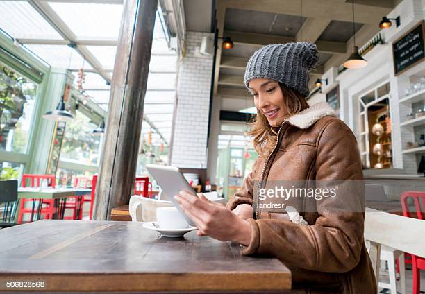 Woman at a cafe using a tablet computer