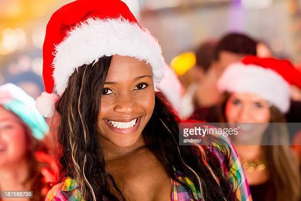 frau auf eine weihnachtsfeier - weihnachtsfrau stock-fotos und bilder