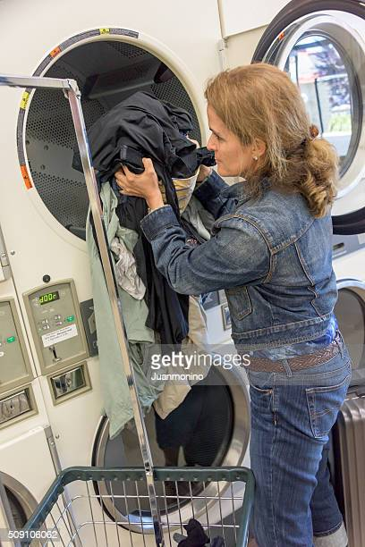 Woman at a coin laundry