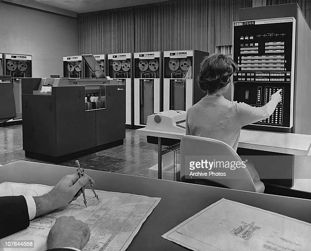 A woman at a design model of the operator's console of the new IBM 7044 mainframe computer White Plains New York USA 20th December 1961