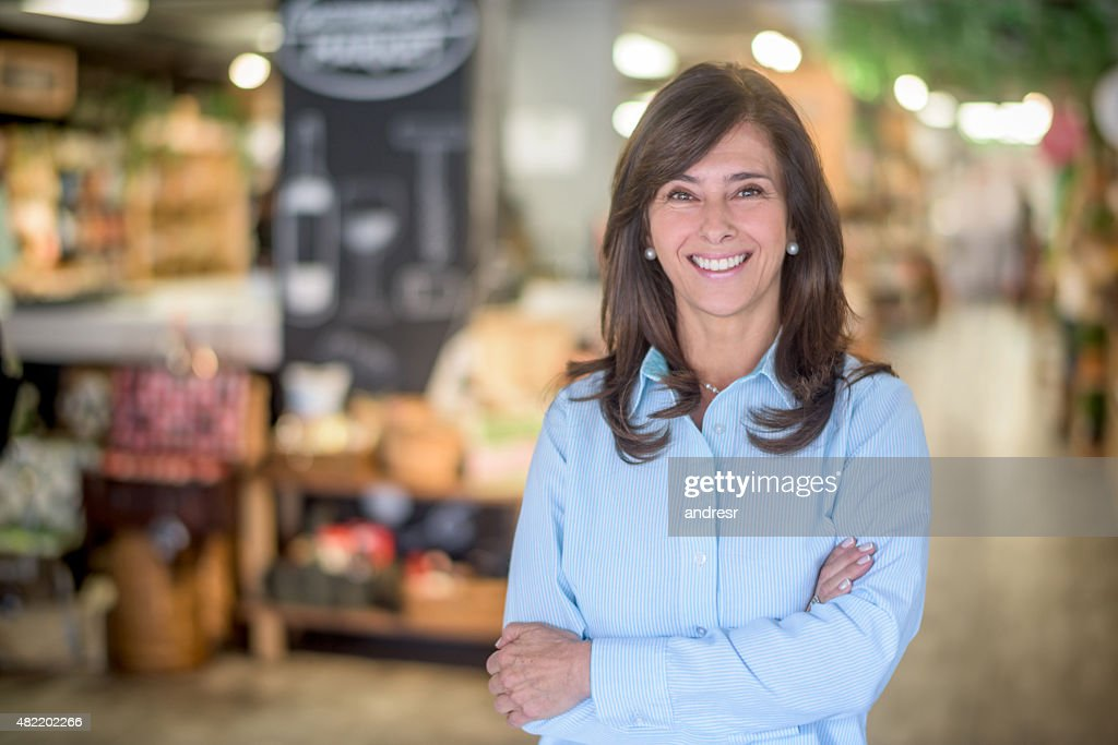 Woman at a food market grocery shopping : Stock Photo