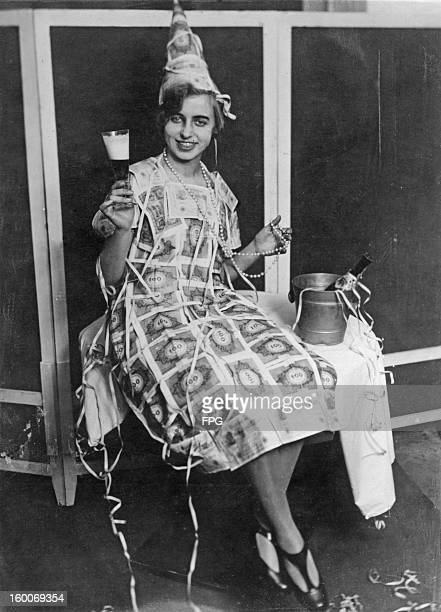 A woman at a masquerade in Amsterdam Holland wears a dress made out of 100 Mark notes circa 1922 The Mark is almost worthless due to a period of...