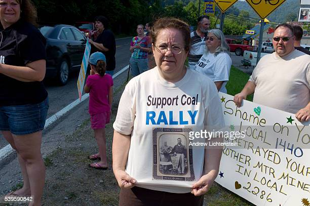 A woman at a small rally to support the coal industry wears a tshirt with a picture of her grandfather on it a miner who fought in the batlle at...