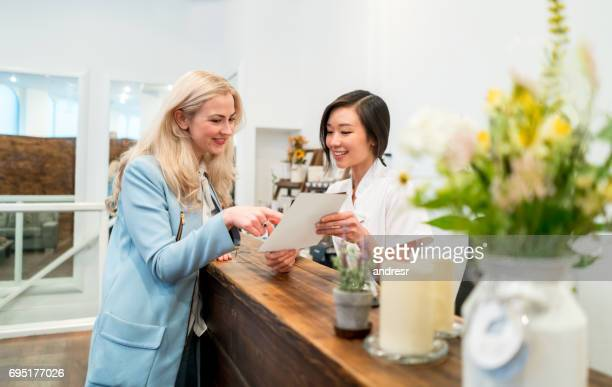 Woman at a spa talking to the business owner