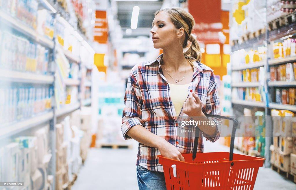 Woman at a supermarket. : Stock Photo