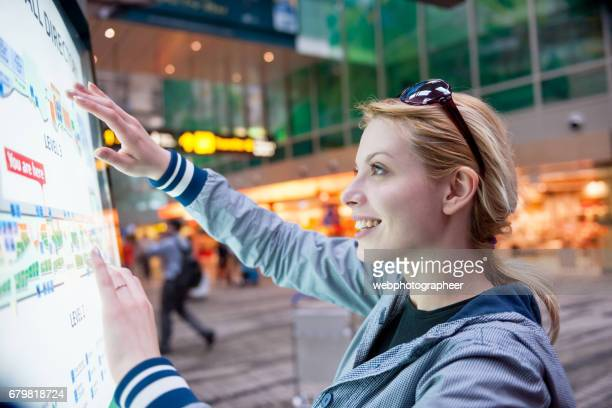 woman at airport - touch sensitive stock pictures, royalty-free photos & images
