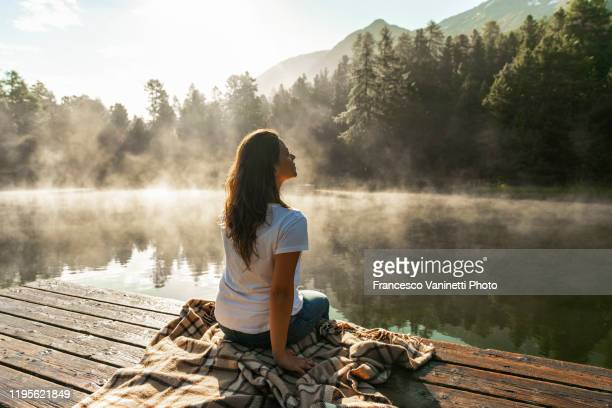 woman at alpine lake, engadin, switzerland. - look back at early colour photography stock pictures, royalty-free photos & images