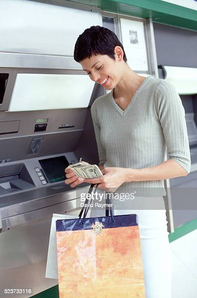 Woman at an ATM