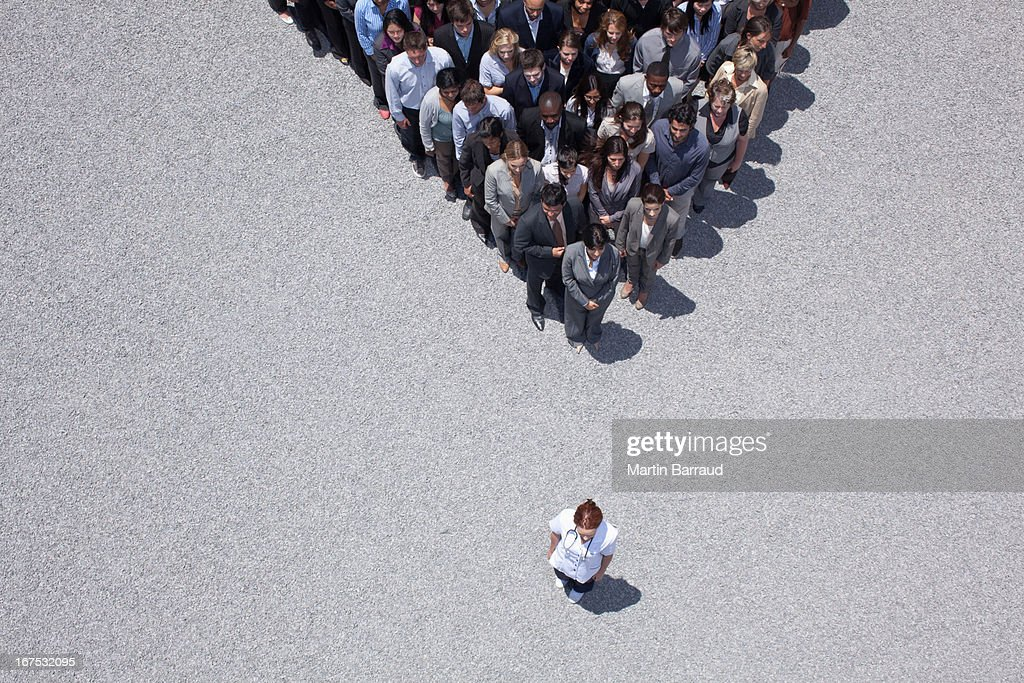 Woman at apex of crowd : Stock Photo
