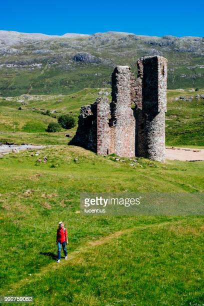 Woman at Ardvreck Castle ruins, Sutherland, Scotland