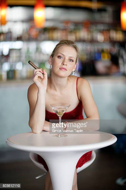 woman at bar - beautiful women smoking cigars stock photos and pictures