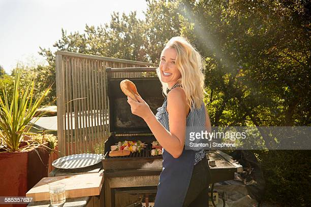 Woman at barbecue party