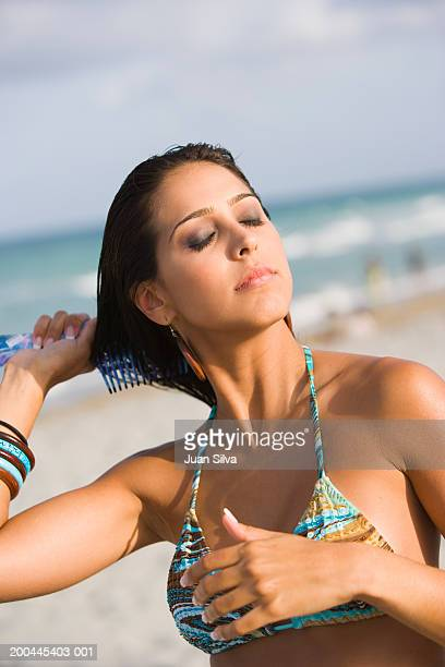 Woman at beach combing her hair