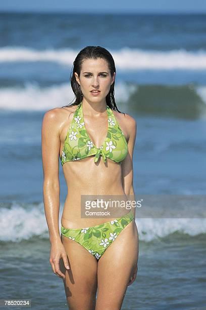 woman at beach in bikini - 接近する 女性 ストックフォトと画像